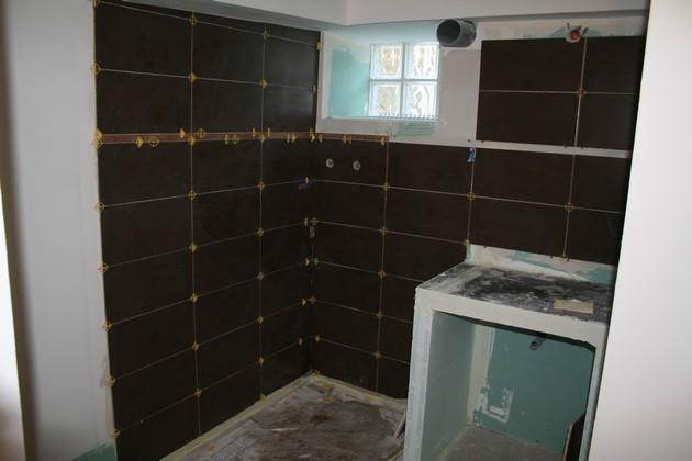 Création d'une salle de bain en sous-sol dans une ancienne cave à charbons